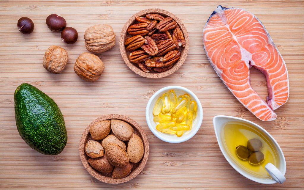 Healthy fat foods including salmon, avocado, nuts