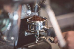 Coffee beans in grinder