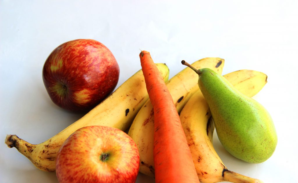 Image of carrots, bananas, apples, and pears