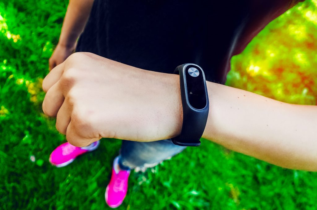 Woman looking at fitness tracker on wrist
