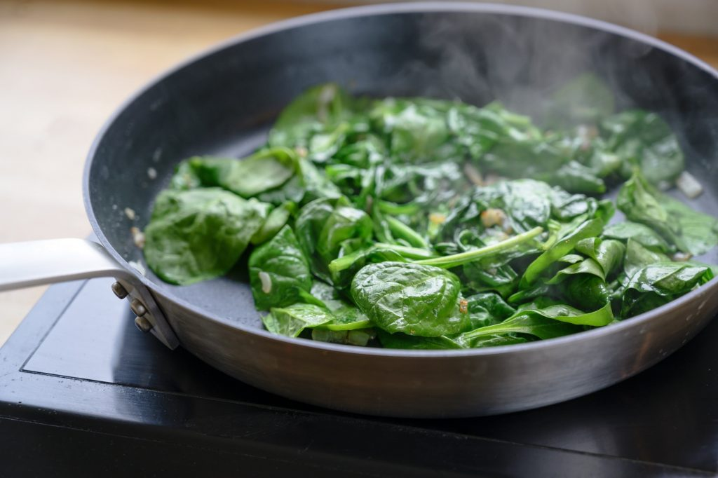 Spinach cooking in a pan
